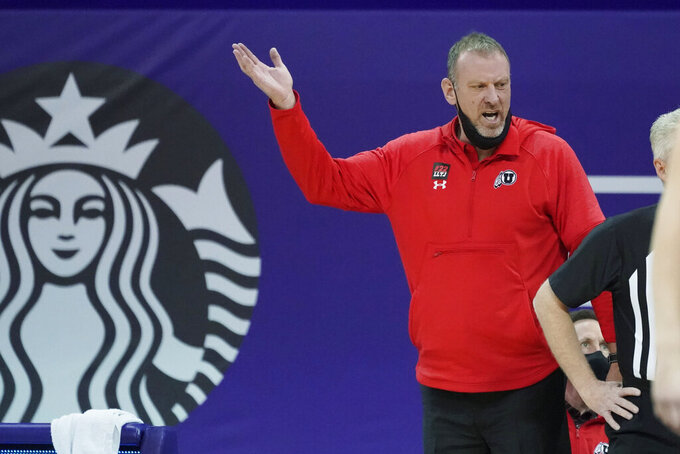 Utah head coach Larry Krystkowiak gestures near the bench during the first half of an NCAA college basketball game against Washington, Sunday, Jan. 24, 2021, in Seattle. (AP Photo/Ted S. Warren)