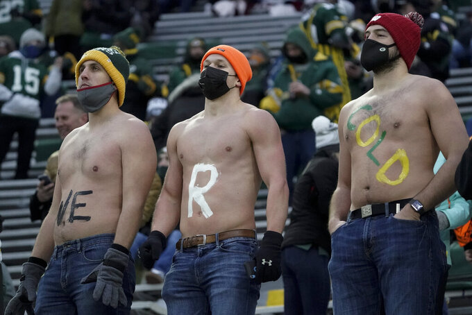 Shirtless fans wait for the start of an NFL divisional playoff football game between the Green Bay Packers and the Los Angeles Rams Saturday, Jan. 16, 2021, in Green Bay, Wis. (AP Photo/Morry Gash)
