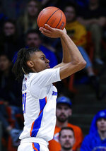 Boise State guard Derrick Alston (21) shoots the ball against Nevada during the first half of an NCAA college basketball game, Tuesday, Jan. 15, 2019, in Boise, Idaho. (AP Photo/Steve Conner)