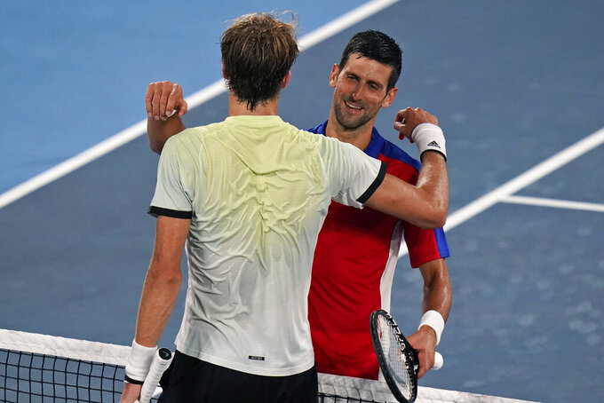 Alexander Zverev, of Germany, left, hugs Novak Djokovic, of Serbia, after defeating him during a semifinals match of the tennis competition at the 2020 Summer Olympics, Friday, July 30, 2021, in Tokyo, Japan. (AP Photo/Seth Wenig)