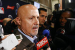 Washington Nationals general manager Mike Rizzo speaks with members of the media as he arrives for the premiere of a documentary film on the team's first World Series baseball championship, Monday, Dec. 2, 2019, in Washington. (AP Photo/Patrick Semansky)