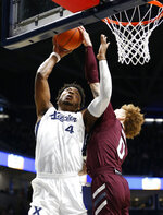 Xavier forward Tyrique Jones (4) has a shot blocked by Missouri State guard Tyrik Dixon (0) during the first half of an NCAA college basketball game, Friday, Nov. 15, 2019, in Cincinnati. (AP Photo/Gary Landers)