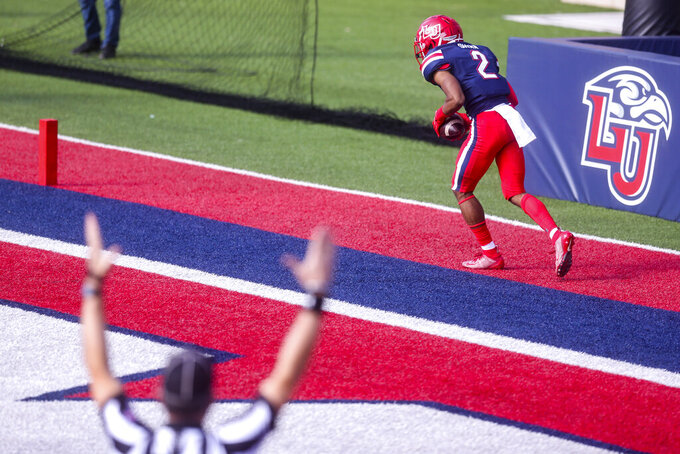 Liberty wide receiver Kevin Shaa (2) celebrate his touchdown during the first half of a NCAA college football game against Massachusetts on Friday, Nov. 27, 2020, at Williams Stadium in Lynchburg, Va. (AP Photo/Shaban Athuman)