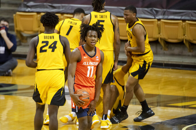 Illinois's Ayo Dosunmu, center, reacts after an offensive foul was called on him during the second half of an NCAA college basketball game against Missouri, Saturday, Dec. 12, 2020, in Columbia, Mo. (AP Photo/L.G. Patterson)
