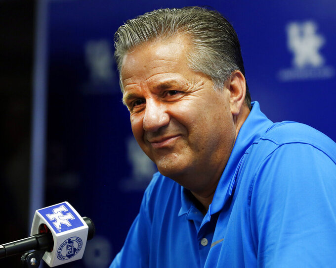 Kentucky head coach John Calipari listens to a question during the university's NCAA college basketball media day, Tuesday, Oct. 1, 2019, in Lexington, Ky. (AP Photo/James Crisp)