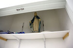 A statue of the Virgin Mary sits in an empty closet of a classroom at Queen of the Rosary Catholic Academy in Brooklyn borough of New York, Thursday, Aug. 6, 2020. Catholic leaders announced in July that a total of 26 New York City area schools will close permanently in August. (AP Photo/Jessie Wardarski)