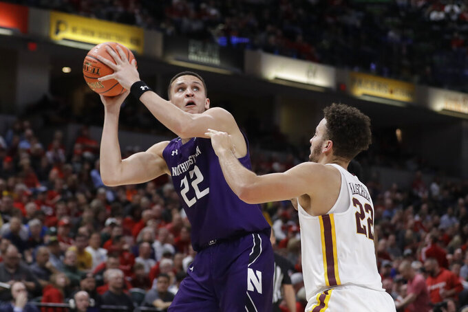Northwestern's Pete Nance (22) shoots over Minnesota's Gabe Kalscheur (22) during the second half of an NCAA college basketball game at the Big Ten Conference tournament, Wednesday, March 11, 2020, in Indianapolis. Minnesota won 74-57. (AP Photo/Darron Cummings)