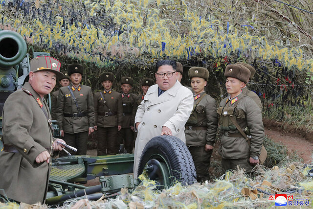 In this undated photo provided on Monday, Nov. 25, 2019, by the North Korean government, North Korean leader Kim Jong Un, center, inspects a military unit on Changrin Islet in North Korea. Independent journalists were not given access to cover the event depicted in this image distributed by the North Korean government. The content of this image is as provided and cannot be independently verified. Korean language watermark on image as provided by source reads: