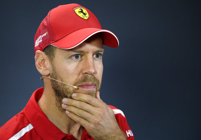 Ferrari driver Sebastian Vettel of Germany answers a question during the drivers press conference ahead of the Australian Formula One Grand Prix in Melbourne, Australia, Thursday, March 14, 2019. The season-opening Australian Grand Prix will be raced here on Sunday, March 17. (AP Photo/Andy Brownbill)