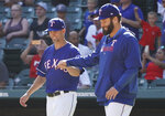 Texas Rangers pitcher Mike Minor, left, gets a fist-bump from pitcher Lance Lynn, right, after the team's baseball game against the Boston Red Sox on Thursday, Sept. 26, 2019, in Arlington, Texas. (AP Photo/Louis DeLuca)