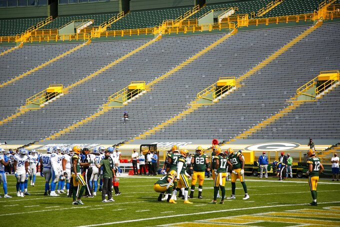 The stands at Lambeau Field are empty during the first half of an NFL football game between the Green Bay Packers and the Detroit Lions Sunday, Sept. 20, 2020, in Green Bay, Wis. (AP Photo/Matt Ludtke)