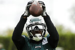 Philadelphia Eagles' Alshon Jeffery catches a pass at the NFL football team's training facility in Philadelphia, Thursday, Oct. 17, 2019. (AP Photo/Matt Rourke)