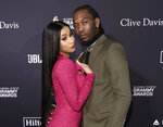 "FILE - Cardi B, left, and Offset arrive at the Pre-Grammy Gala And Salute To Industry Icons in Beverly Hills, Calif. on  Jan. 25, 2020. Cardi B has filed for divorce from Offset, claiming her marriage was ""irretrievably broken."" A Fulton County Courthouse filing states that she filed the divorce documents Tuesday in Atlanta. (Photo by Mark Von Holden/Invision/AP, File)"