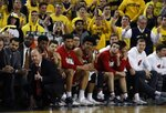 The Wisconsin bench watches during the closing seconds of the second half of an NCAA college basketball game against Michigan, Saturday, Feb. 9, 2019, in Ann Arbor, Mich. (AP Photo/Carlos Osorio)