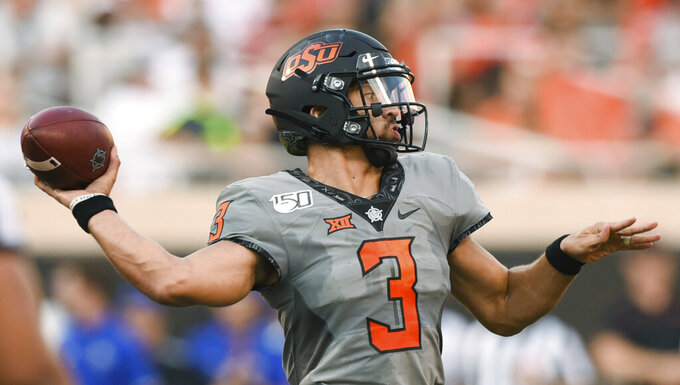 Oklahoma State starting quarterback Spencer Sanders throws a pass during the first half of the team's NCAA college football game against McNeese State in Stillwater, Okla., Saturday, Sept. 7, 2019. (AP Photo/Brody Schmidt)