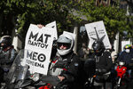 A protester holds a banner which reads in Greek