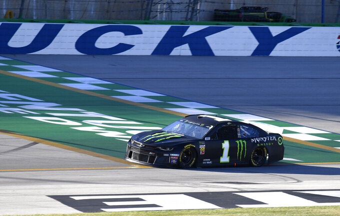Kurt Busch crosses the line during qualifying for a NASCAR Series auto race at Kentucky Speedway in Sparta, Ky., Friday, July 12, 2019. (AP Photo/Timothy D. Easley)