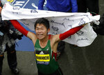 Yuki Kawauchi, of Japan, celebrates after winning the 122nd Boston Marathon on Monday, April 16, 2018, in Boston. He is the first Japanese man to win the race since 1987. (AP Photo/Charles Krupa