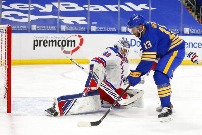 Buffalo Sabres forward Tobias Rieder (13) puts the puck past New York Rangers goalie Alexandar Georgiev (40) during the second period of an NHL hockey game, Tuesday, Jan. 26, 2021, in Buffalo, N.Y. (AP Photo/Jeffrey T. Barnes)