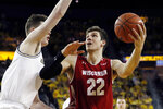 Wisconsin forward Ethan Happ (22) looks to shoot as Michigan center Jon Teske defends during the first half of an NCAA college basketball game, Saturday, Feb. 9, 2019, in Ann Arbor, Mich. (AP Photo/Carlos Osorio)