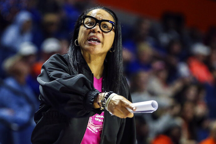 FILE - In this Feb. 27, 2020, file photo, South Carolina head coach Dawn Staley reacts to an official's call during the second half of an NCAA college basketball game against Florida in Gainesville, Fla. Staley says her players are eager to finish what they couldn't in the spring of 2020. The Gamecocks were No. 1 in the country but the season was called off due to COVID-19 leaving the Gamecocks wondering what might've been. (AP Photo/Gary McCullough, File)