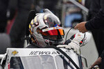 Josef Newgarden climbs into his car during testing at the Indianapolis Motor Speedway, Thursday, April 8, 2021, in Indianapolis. (AP Photo/Darron Cummings)