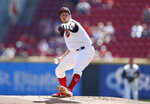 Cincinnati Reds starting pitcher Trevor Bauer (27) delivers against the New York Mets during the first inning of a baseball game, Sunday, Sept. 22, 2019, in Cincinnati. (AP Photo/Gary Landers)