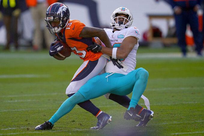 Denver Broncos wide receiver K.J. Hamler (13) is tackled by Miami Dolphins defensive back Nik Needham during the first half of an NFL football game, Sunday, Nov. 22, 2020, in Denver. (AP Photo/David Zalubowski)