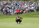 Brooks Koepka lines up a putt on the fifth green during the first round of the PGA Championship golf tournament, Thursday, May 16, 2019, at Bethpage Black in Farmingdale, N.Y. (AP Photo/Julio Cortez)
