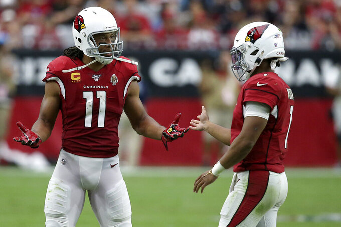 Arizona Cardinals wide receiver Larry Fitzgerald (11) talks with quarterback Kyler Murray (1) during the second half of an NFL football game against the Carolina Panthers, Sunday, Sept. 22, 2019, in Glendale, Ariz. (AP Photo/Ross D. Franklin)