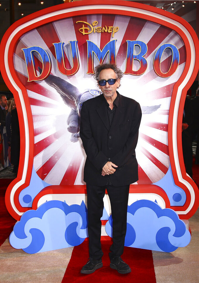 """FILE - Tim Burton arrives at the premiere of """"Dumbo"""" in London on March 21, 2019. Burton turns 63 on Aug. 25. (Photo by Joel C Ryan/Invision/AP, File)"""