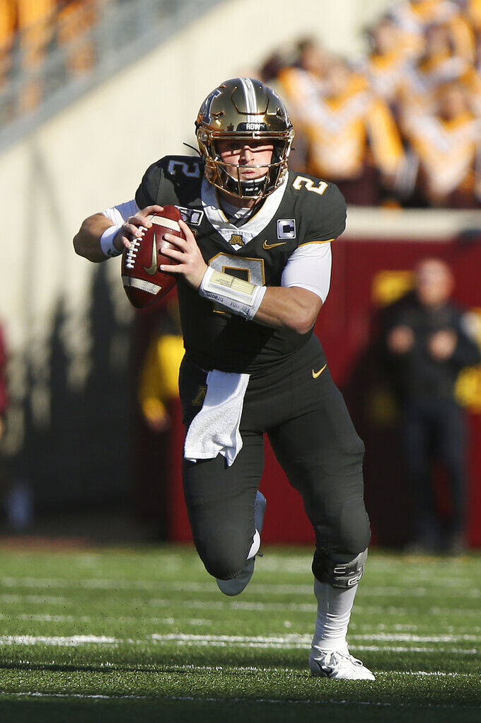 FILE - In this Oct. 26, 2019, file photo, Minnesota quarterback Tanner Morgan runs with the ball during an NCAA college football game against Maryland in Minneapolis.Fans of Minnesota's Golden Gophers are enjoying football success the team hasn't seen in decades, and daring to dream of a trip to Pasadena. (AP Photo/Stacy Bengs,Fie)