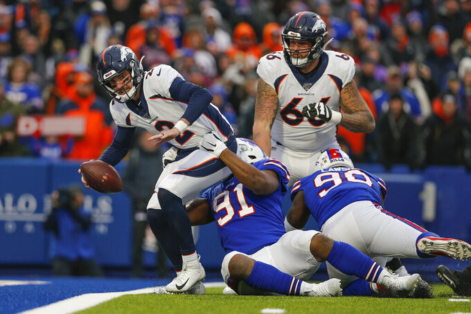 Buffalo Bills defensive tackle Ed Oliver (91) pulls down Denver Broncos quarterback Brandon Allen (2) into the end zone for a sack during the fourth quarter of an NFL football game, Sunday, Nov. 24, 2019, in Orchard Park, N.Y. (AP Photo/John Munson)