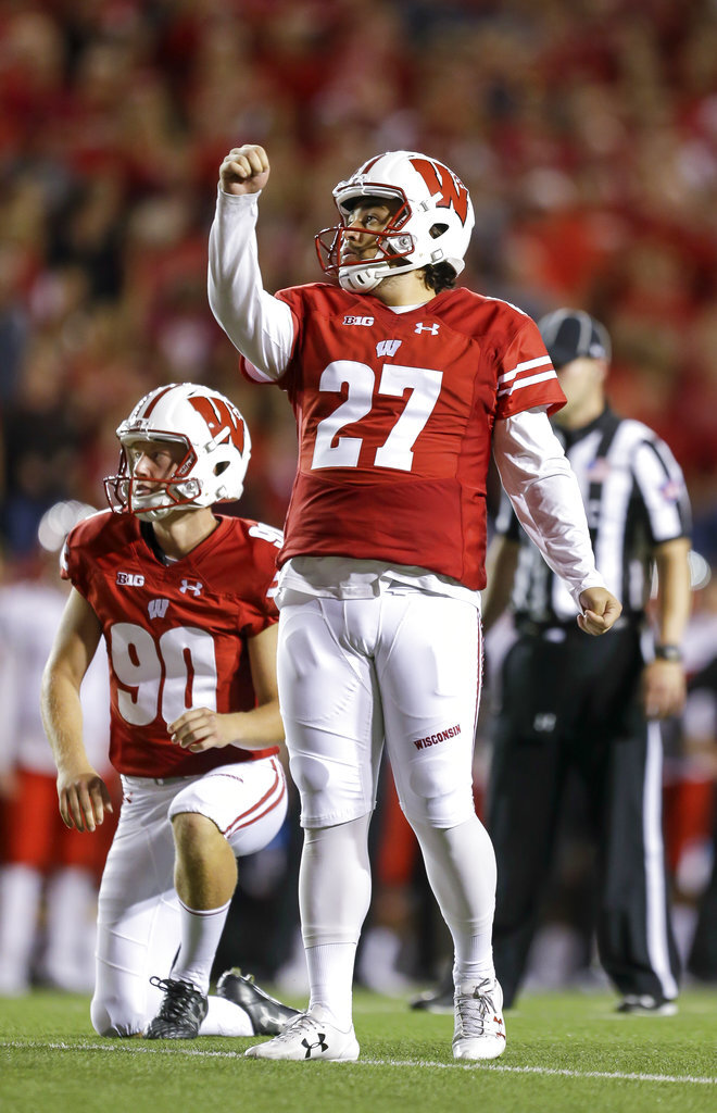 Wisconsin place-kicker Rafael Gaglianone (27) and teammate Connor Allen watch a successful extra point against Western Kentucky during the first half of an NCAA college football game Friday, Aug. 31, 2018, in Madison, Wis. (AP Photo/Andy Manis)