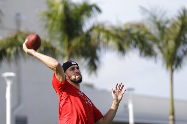Boston Red Sox relief pitcher Matt Barnes (32) throws a football after reporting for spring training baseball Tuesday, Feb. 11, 2020, in Fort Myers, Fla. (AP Photo/John Bazemore)