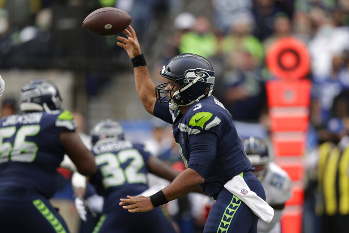 Seattle Seahawks quarterback Russell Wilson passes against the Tennessee Titans during the second half of an NFL football game, Sunday, Sept. 19, 2021, in Seattle. (AP Photo/John Froschauer)
