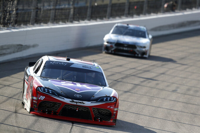 Christopher Bell leads the pack in turn one of the NASCAR Xfinity Series auto race, Saturday, July 27, 2019, at Iowa Speedway in Newton, Iowa. (AP Photo/Matthew Putney)