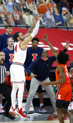 Ohio State guard Duane Washington, left, goes up to shoot against Illinois guard Ayo Dosunmu during the first half of an NCAA college basketball game in Columbus, Ohio, Saturday, March 6, 2021. (AP Photo/Paul Vernon)