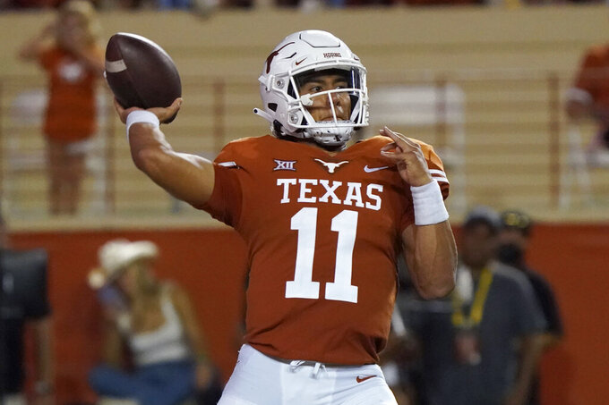 Texas quarterback Casey Thompson (11) looks to throw a pass against the Rice during the first half of an NCAA college football game Saturday, Sept. 18, 2021, in Austin, Texas. (AP Photo/Chuck Burton)