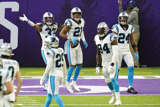 Carolina Panthers safety Jeremy Chinn (21) celebrates with teammates after returning a fumble 17-yards for a touchdown during the second half of an NFL football game against the Minnesota Vikings, Sunday, Nov. 29, 2020, in Minneapolis. (AP Photo/Jim Mone)