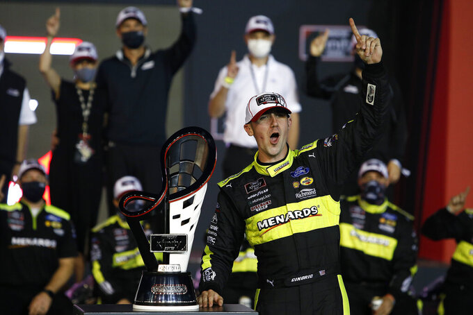 Austin Cindric celebrates in Victory Lane with the season championship trophy after winning a NASCAR Xfinity Series auto race at Phoenix Raceway, Saturday, Nov. 7, 2020, in Avondale, Ariz. (AP Photo/Ralph Freso)