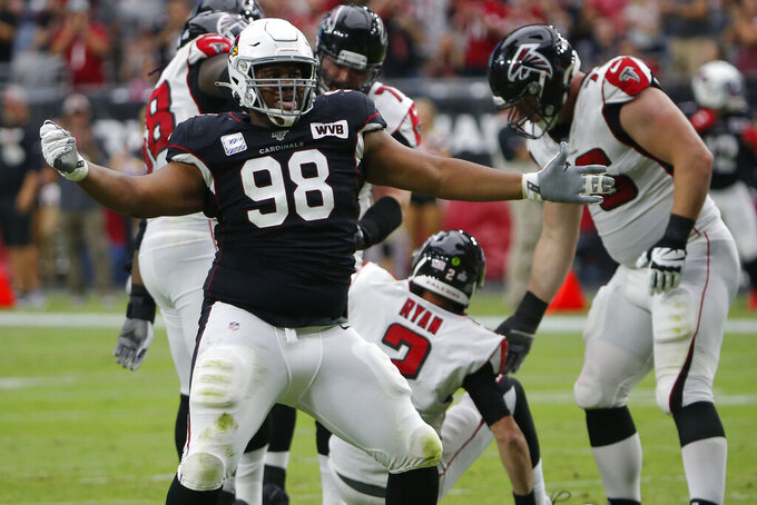 Arizona Cardinals defensive tackle Corey Peters (98) celebrates his sack of Atlanta Falcons quarterback Matt Ryan (2) during the first half of an NFL football game, Sunday, Oct. 13, 2019, in Glendale, Ariz. (AP Photo/Rick Scuteri)