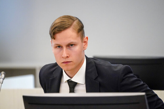 """Defendant Philip Manshaus appears in court on charges of murder and terrorism in Olso, Norway, Thursday May, 7, 2020. Manshaus suspected of killing his stepsister and then storming an Oslo mosque with firearms """"with the intention to kill as many Muslims as possible,"""" has appeared in court, charged with murder and terror.  Philip Manshaus has denied the charges.  (Lise Åserud / NTB scanpix via AP)"""