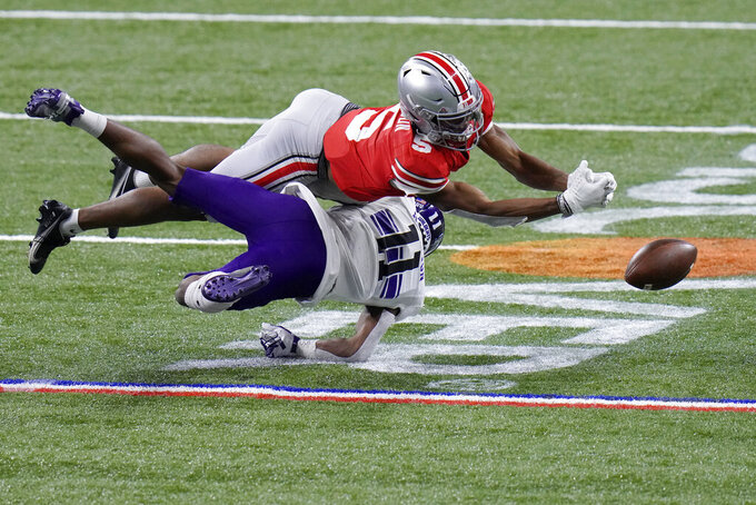 Northwestern defensive back A.J. Hampton (11) breaks up a pass intended for Ohio State wide receiver Garrett Wilson (5) during the first half of the Big Ten championship NCAA college football game, Saturday, Dec. 19, 2020, in Indianapolis. (AP Photo/AJ Mast)