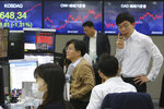 Currency traders work at the foreign exchange dealing room of the KEB Hana Bank headquarters in Seoul, South Korea, Wednesday, Feb. 26, 2020. Asian shares slid Wednesday following another sharp fall on Wall Street as fears spread that the growing virus outbreak will put the brakes on the global economy.(AP Photo/Ahn Young-joon)