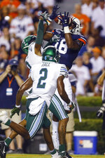 Auburn wide receiver Seth Williams (18) catches a pass over Tulane cornerback Willie Langham (8) and safety P.J. Hall (2) during the second quarter of an NCAA college football game Saturday, Sept. 7, 2019, in Auburn, Ala. (AP Photo/Butch Dill)