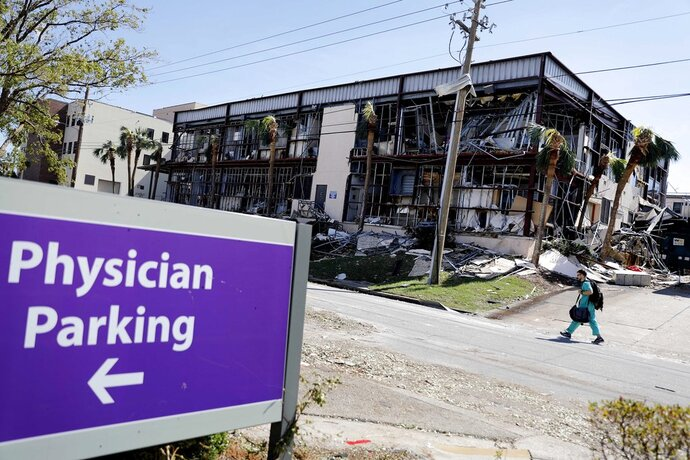 FILE- This Oct. 11, 2018 file photo shows a building at the Bay Medical Center Sacred Heart hospital damaged from hurricane Michael in Panama City, Fla. Medical services in the Florida Panhandle are still on life support more than a week after Hurricane Michael. The two major hospitals in Panama City, Bay Medical and Gulf Coast Regional Medical Center, still aren't admitting patients. They are only open for emergency room services. (AP Photo/David Goldman, File)