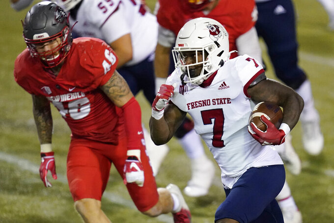 Fresno State running back Jordan Mims (7) makes a touchdown run against New Mexico during the first half of an NCAA college football game Saturday, Dec. 12, 2020, in Las Vegas. (AP Photo/John Locher)
