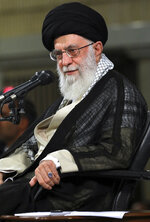 In this Sunday, June 10, 2018 photo, released by an official website of the office of the Iranian supreme leader, Supreme Leader Ayatollah Ali Khamenei attends a meeting with a group of academics in Tehran, Iran. Ayatollah Ali Khamenei was quoted by the official IRNA news agency late Sunday as saying the Mideast conflict should be resolved through a popular referendum among