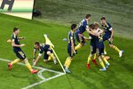 Rostov's players celebrate after scoring their side's goal during a Russia Soccer Premier League soccer match against FC Sochi as the league was resumed after a three-month hiatus because of the coronavirus pandemic in Sochi, Russia, Friday, June 19, 2020. Rostov fielded a team of teenagers because its entire first-team squad is in isolation following a suspected outbreak of coronavirus. The match is being played with a minimum spectators to curb the spread of COVID-19. (AP Photo)